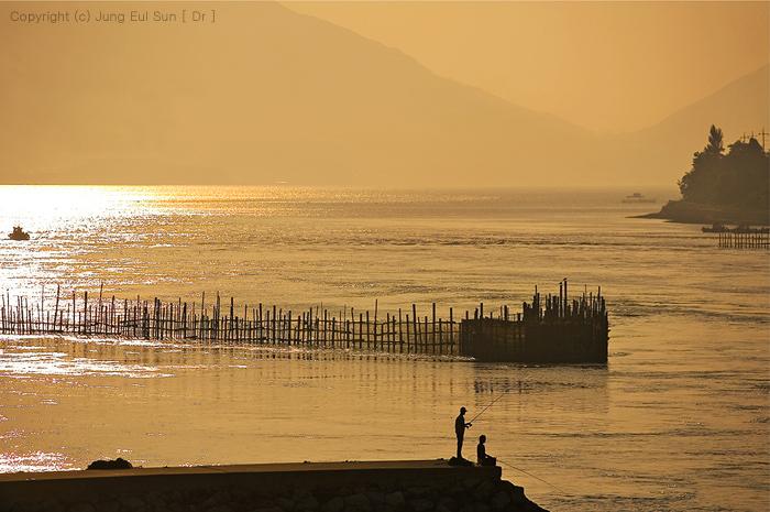 日が暮れる海辺・・・