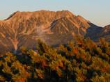 夕日浴びる立山