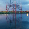 田んぼの中の赤い鉄塔